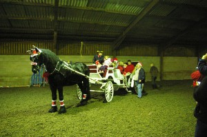 Father Christmas in his horse & carriage with friends