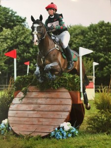 Olivia flying over one of the fences!
