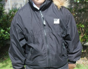 spc coat with name blanked out