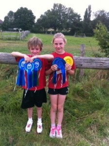 Oli and Katie collect their ribbons