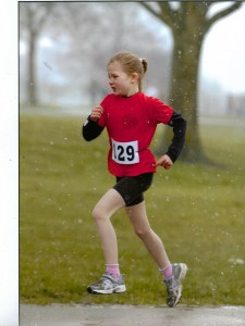 Zoe Sollis running in the snow at Ardingly